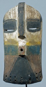 WOODEN-BASONGE-KIFWEBE-MASK-WITH-PROJECTING-MOUTH-LARGE-NOSE-NARROW-EYES-LINEAR-CARVING-AND-PIGMENTS-ZAIRE-AFRICA