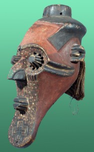 WOODEN-KETE-MASK-OR-BENA-BIOMBO-WITH-SLENDER-FACE-MULTIPLE-EYE-HOLES-WITH-PROJECTIONS-CROWN-PROJECTION-AND-PIGMENTS-ZAIRE-AFRICA