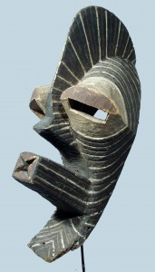 WOODEN-SONGE-KIFWEBE-MASK-WITH-LONG-MOUTH-LARGE-EYES-AND-CREST-OVERALL-LINEAR-CARVING-AND-PIGMENTS-ZAIRE-AFRICA