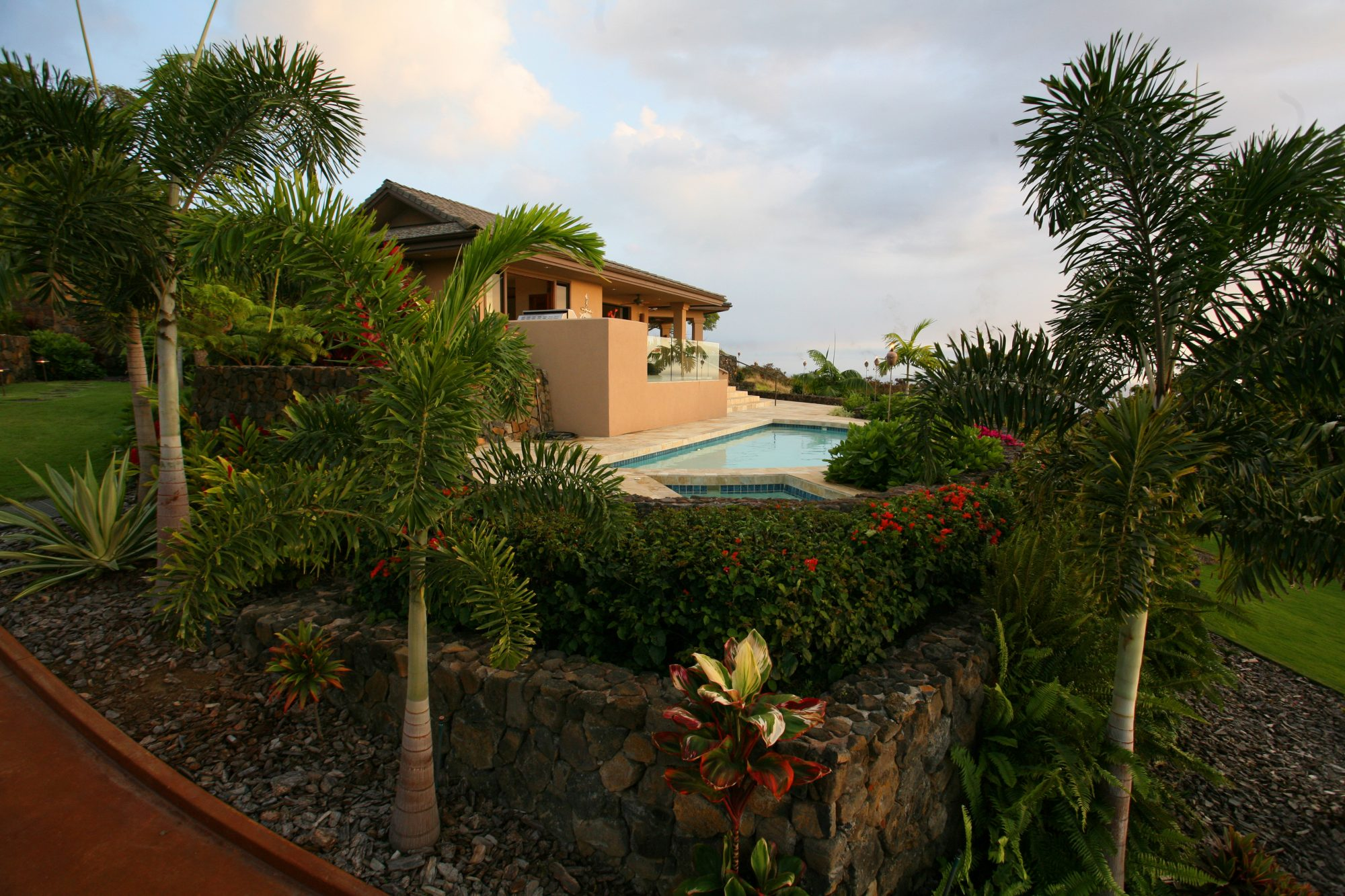*The Auamo Compound, Elevation and Pool Through the Palms